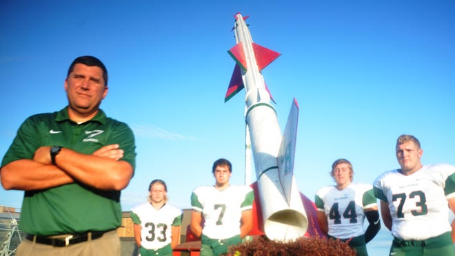 Oak Harbor football coach Mike May along with Rocket captains (left to right) Rhett Petersen, Noah Harder, Kyle Pape and Brandon Garber are determined to get their team back to its traditional level of success.
