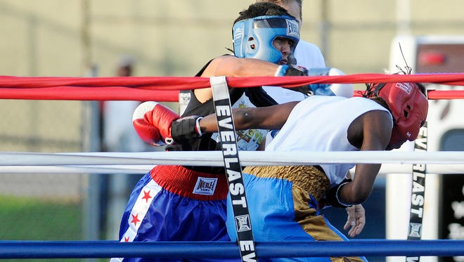 Fighters exchange punches while competing in the APJ Boxing Club fund raiser on Saturday in Poughkeepsie.