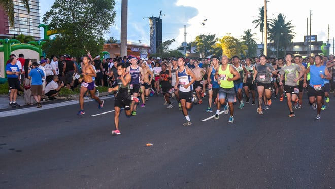 Runners and other participants launch off the starting line during the 2017 eCoast 5K Run & Family Fair, hosted by Coast360, at the financial institution's Maite branch on Saturday. Sept. 23, 2017.