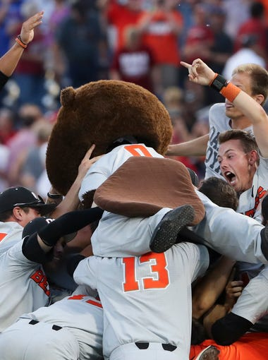 Jun 28, 2018; Omaha, NE, USA; The Oregon State Beavers celebrate after game three of the championship series of the College World Series against the Arkansas Razorbacks at TD Ameritrade Park. Mandatory Credit: Luke Franke-USA TODAY Sports