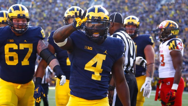 De'Veon Smith of the Michigan Wolverines celebrates a first-half touchdown against Maryland on Nov. 5, 2016, at Michigan Stadium in Ann Arbor.