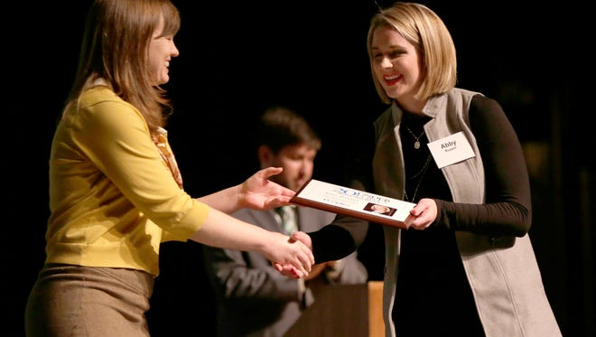 Amy Ruppel, (R) shakes hands with Nora Hertel, public issues investigator during the 20 Under 40 event held at the Grand Theatre Wednesday, November 16, 2016 in Wausau, Wisconsin.
