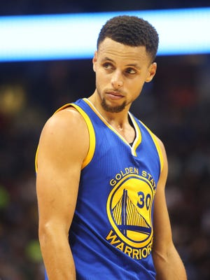 Golden State Warriors guard Stephen Curry looks on during the second half against the Denver Nuggets at Pepsi Center.