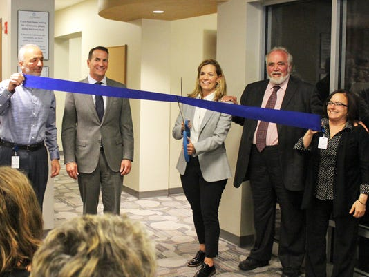 636299392631749393-ribbon-cutting.jpg