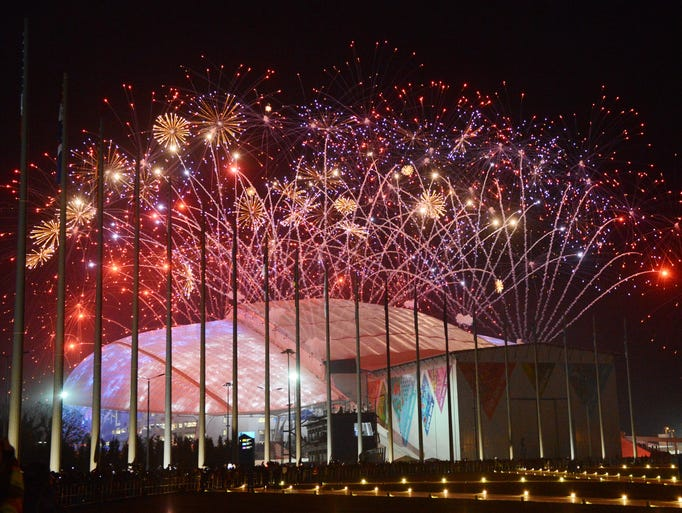 Fireworks explode during the opening ceremony for the Sochi 2014 Olympic Winter Games at Fisht Olympic Stadium.