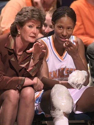 Tennessee head coach Pat Summitt talks with Chamique Holdsclaw on the bench as Holdsclaw ices her knees in the final minutes of their game against Florida at the SEC women's tournament in Chattanooga, Tenn. on Friday, Feb. 26, 1999. Tennessee defeated Florida, 92-80, to advance to the semifinal round of the tournament.