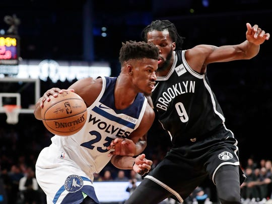Minnesota Timberwolves' Jimmy Butler (23) drives past
