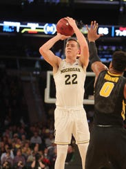 Duncan Robinson scored 11 points with three 3-pointers in Michigan's 77-71 overtime win Thursday.