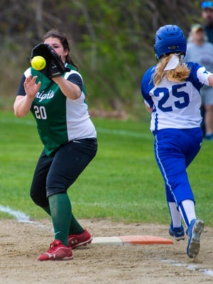 Rice's Rebecca Chicoine, left, gloves the ball as Missisquoi's Lauren Perkins is out at first in South Burlington on Thursday, May 19, 2016.