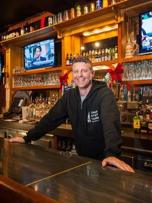 Stephen Parent behind the bar at the Church Street Tavern in Burlington on Tuesday, December 6, 2016.