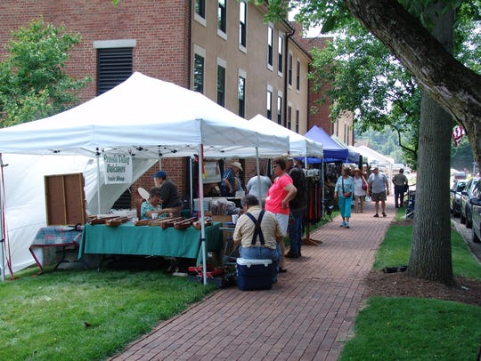 Visitors stop by vendor tents in Roscoe Village during