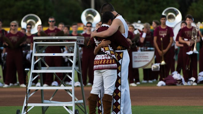 "All three drum majors embrace in tears after conducting ""Amazing Grace"" during the 10/10/15 Skull Session at the Miami Game"