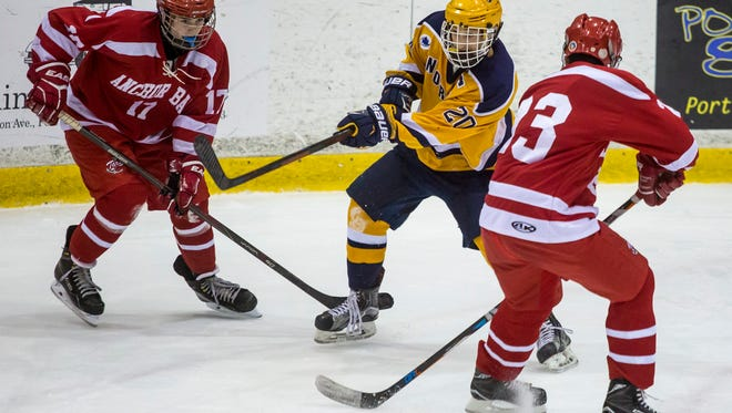 Port Huron Northern's Dakota Truscott takes a shot on goal between Anchor Bay's Curtis Kwentus and Nick Morabito during the Larry Manz hockey tournament Saturday, Nov. 26, 2016 at McMorran Arena in Port Huron.