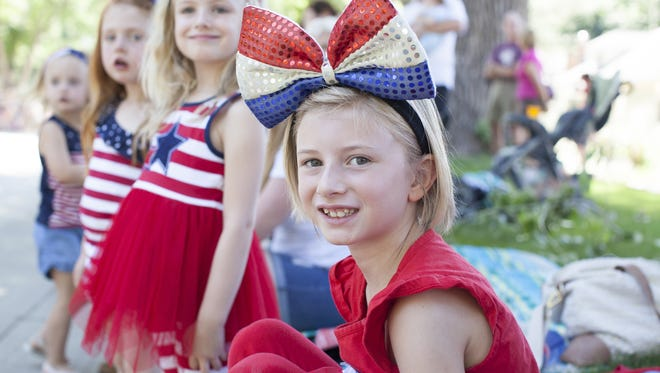 Avery Bartholomew, age 8, dressed patriotically to attend the 2017 4th of July Parade in Fort Collins on Tuesday.