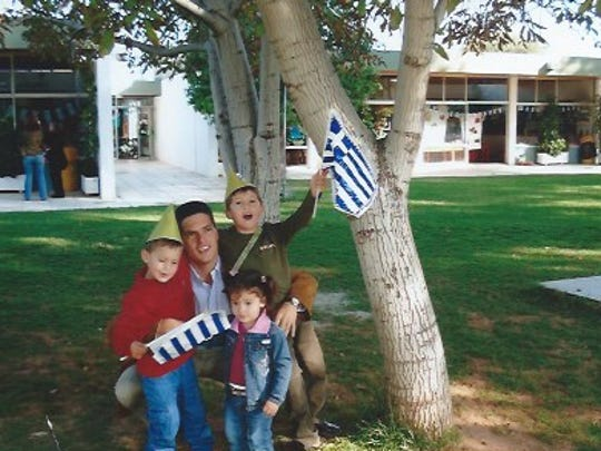 Matt Karlaftis with his two oldest sons George and Yanni and daughter Annie.