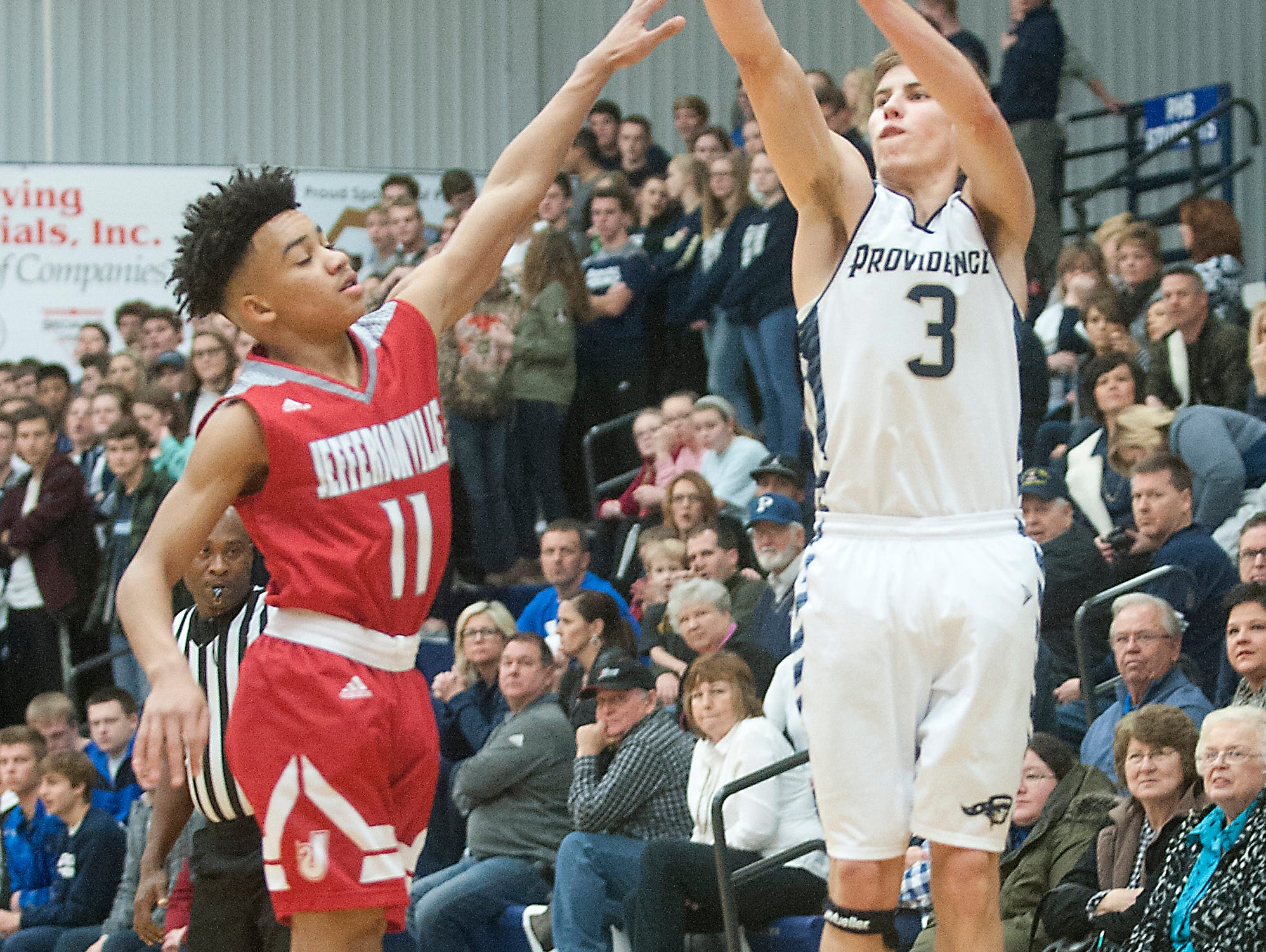 Providence guard Juston Betz shoots a three-pointer over Jeffersonville guard Jacob Jones. 14 January 2017