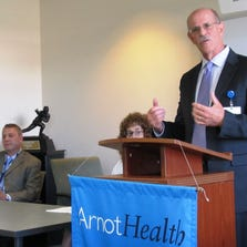 Dr. Robert K. Lambert, president and chief executive officer of Arnot Health, announces its new culinary medicine program for medical students at a press conference on Monday.