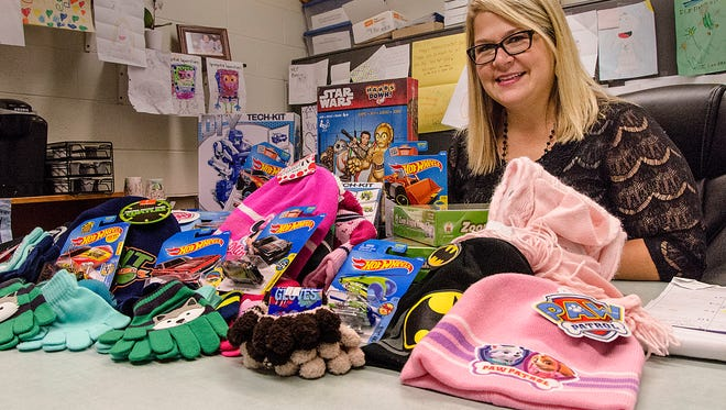 Hicks Elementary Principal Amy Gee, with some of the gifts for her students.
