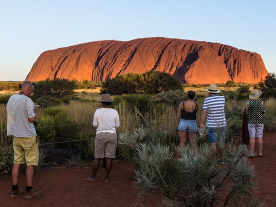 636592477387543798-Uluru---Visitors-stand-spellbound-and-transfixed-by-the-sheer-beauty.jpg