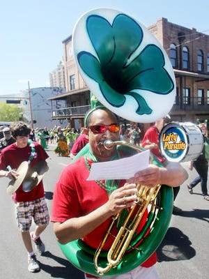 A three-leaf clover, painted on the inside of a tuba, helped to celebrate St. Patrick's Day during the 2013 parade.