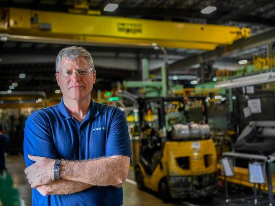 Jim Leyhew heads the Kasai North America factory in Manchester, Tennessee. He's thinking of investing in five robots to join a labor force of about 850 workers and some 75 other automated machines.