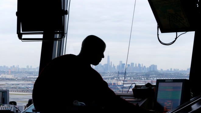 An air traffic controller works in the tower at Newark Liberty International Airport in Newark, N.J., on May 21, 2015. Four airline crews reported drone sightings Sunday while approaching the airport to  land.