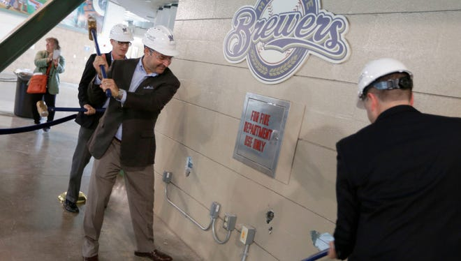 A ceremonial wall demolition took place on an old concession stand on the third base side in what will be the new third base ward. Taking part were Brewers Chief Operating Officer Rick Schlesinger (from left); John Sergi, the co-owner of Howard and Sergi, a hospitality design consultant; and Ken Gaber, general manager with food services Delaware North.