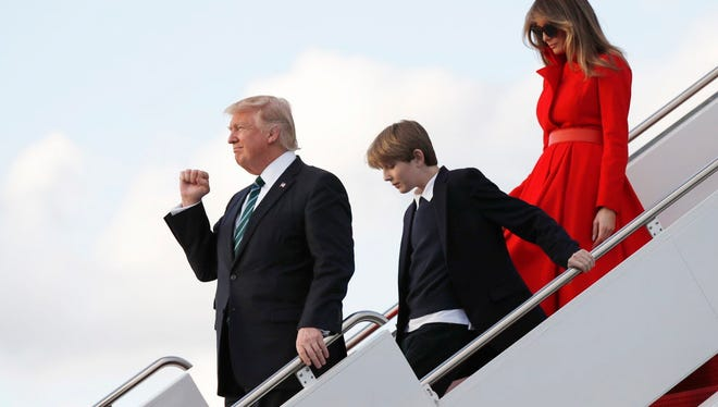President Donald Trump with First Lady Melania and their son Barron.