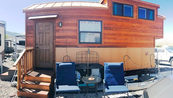 In a May 7, 2018 photo, Amy Killeen's tiny house is made like any other house, with real materials such as hardwood, corrugated metal, and cork flooring. It just happens to roll.