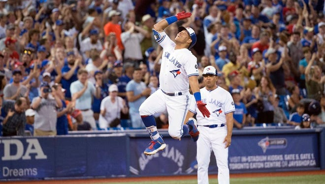 Jul 3, 2018; Toronto, Ontario, CAN; Toronto Blue Jays second baseman Yangervis Solarte (26) celebrates after hitting a three run home run during the seventh inning against the New York Mets at Rogers Centre.