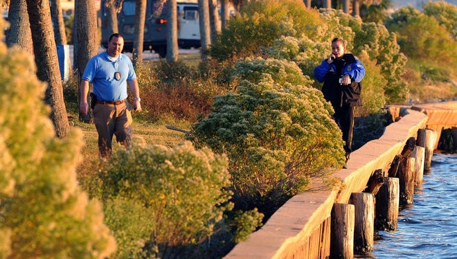 Pensacola Police work the scene where a dead body was discovered in the water at Wayside Park Sunday evening.