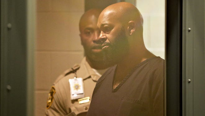 Suge Knight, seen here in a Las Vegas jail, is a fugitive in California, where he's charged with stealing a photographer's camera.