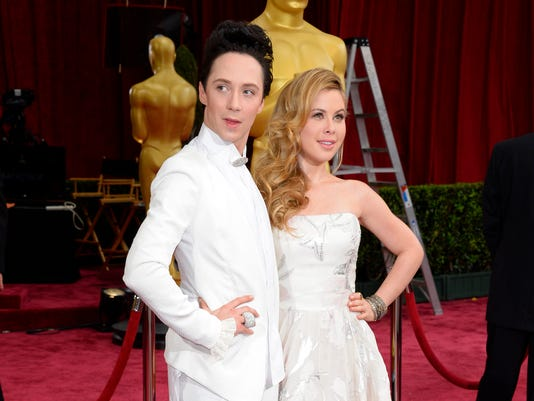 FILE - This March 2, 2014, file photo shows Johnny Weir, left, and Tara Lipinski at the Oscars in Los Angeles. Weir and Lipinski will serve as correspondents for NBC's coverage of the Rio de Janeiro Olympics. The network announced Monday, May 2, 2016, that the NBC Sports figure skating analysts will explore Rio's culture, sights, sounds and fashion during the games in August. (Photo by Dan Steinberg/Invision/AP, File)