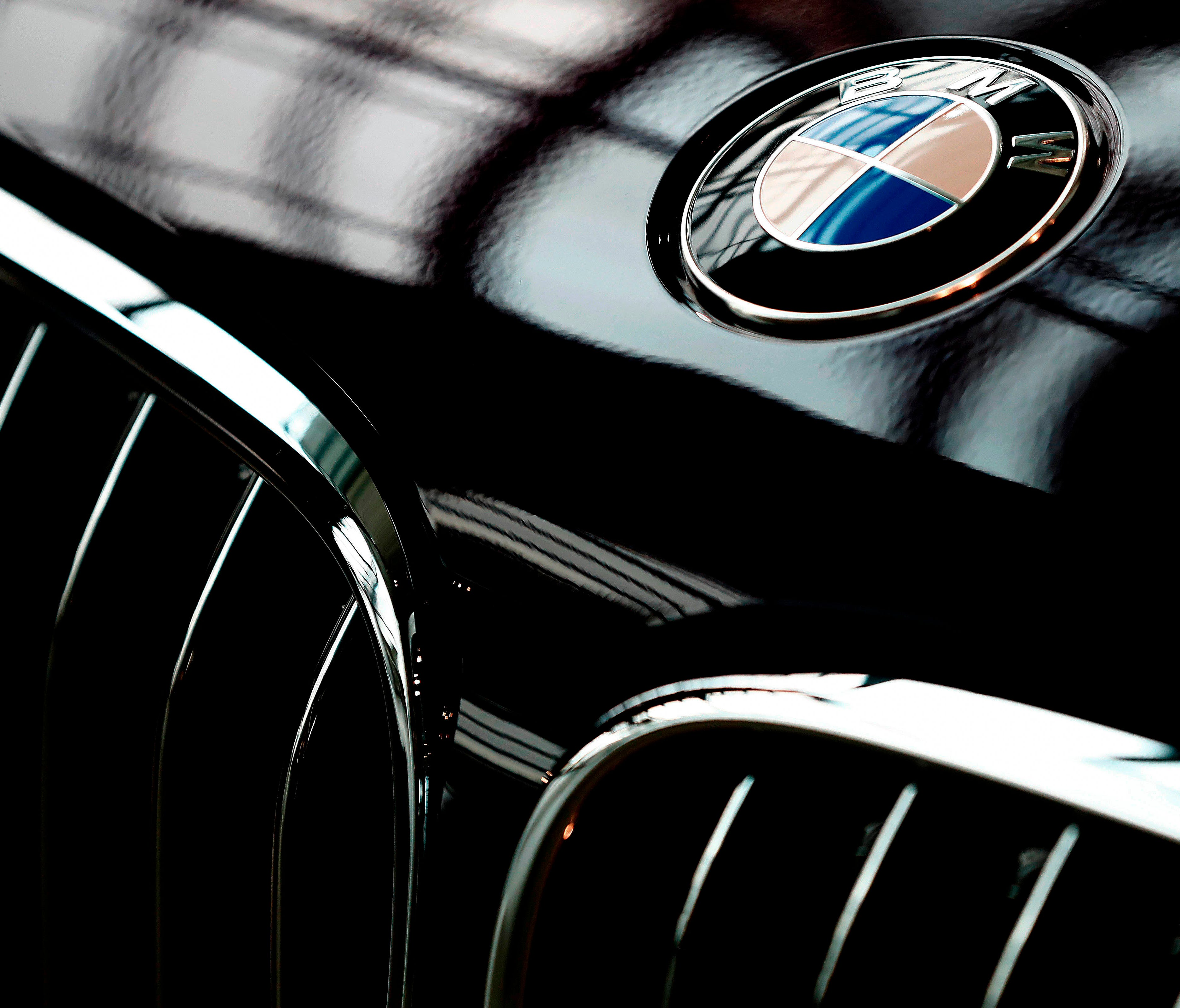 In this March 21, 2018, file photo, the logo of German car manufacturer BMW is pictured on a BMW 7 car prior to the earnings press conference in Munich, Germany.