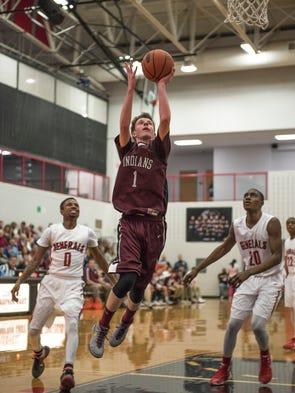 Southern Fulton's Carl Potter takes a shot at the basket