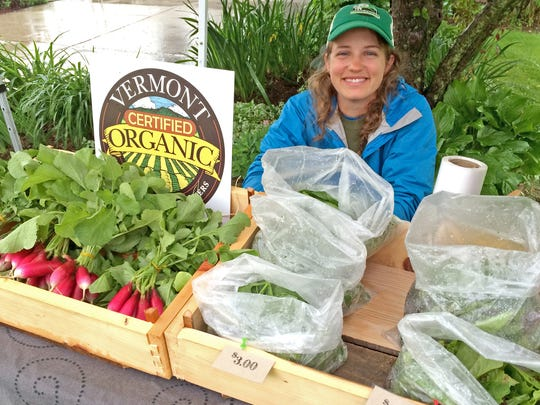 Farmer Taylor Hutchison (shown here) and her partner, Jake Mendell, own Footprint Farm of Starksboro, a repeat vendor at the Hinesburg Lions Farmers Market.
