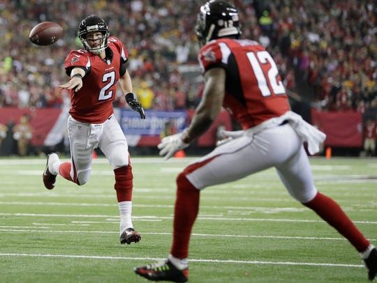 Atlanta quarterback Matt Ryan throws a touchdown pass