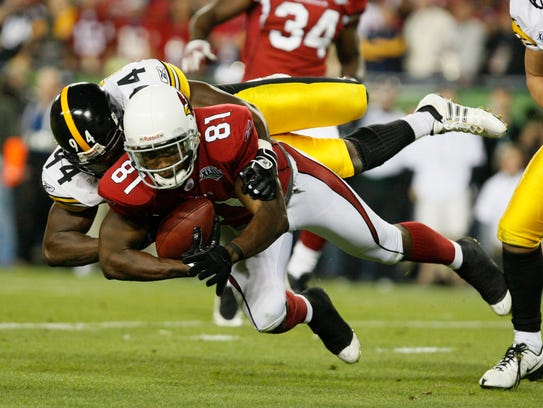 Lawrence Timmons of the Steelers tackles Anquan Boldin