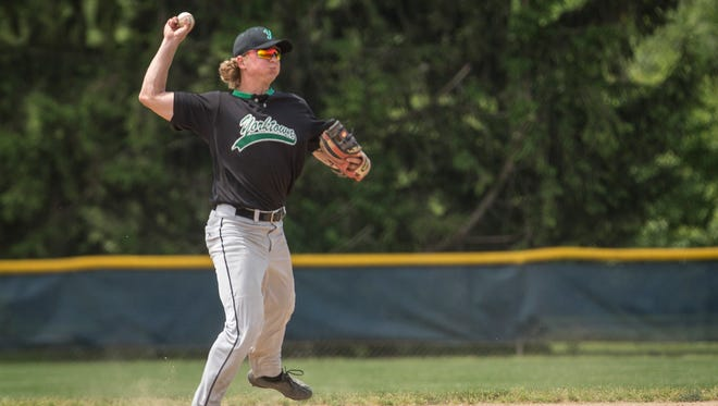 Cole Barr makes a throw during Yorktown's game against Norwell in the semifinal of the IHSAA Class 3A Regional on June 3 at Bellmont High School in Decatur. Yorktown won 3-2.