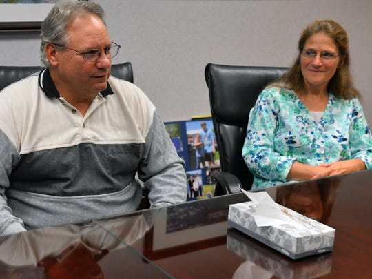 Brian Guilford and wife Becky gather with their family to talk about their memories of son Deven Guilford in an interview with the Lansing State Journal on Monday.