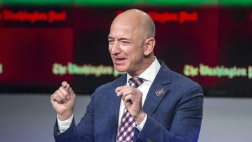 Amazon founder and Washington Post owner Jeff Bezos talks about the history and character of the Post during a dedication ceremony for its new headquarters in Washington.