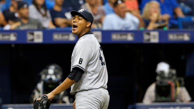 New York Yankees starting pitcher Ivan Nova has words toward home plate umpire Laz Diaz after being removed during the fifth inning of a baseball game against the Tampa Bay Rays, Friday, July 29, 2016, in St. Petersburg, Fla.