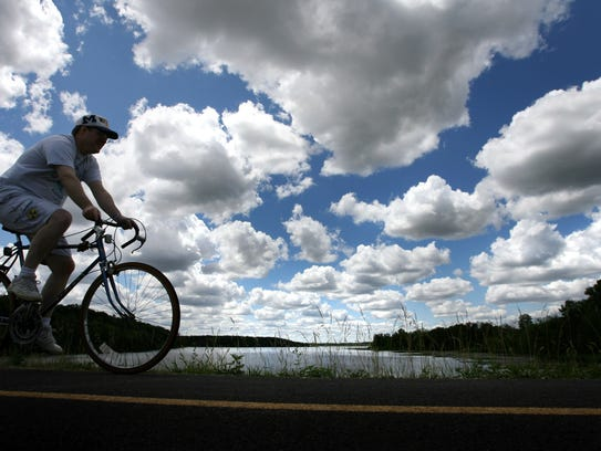 A biker rides through the trails at Stony Creek Metropark