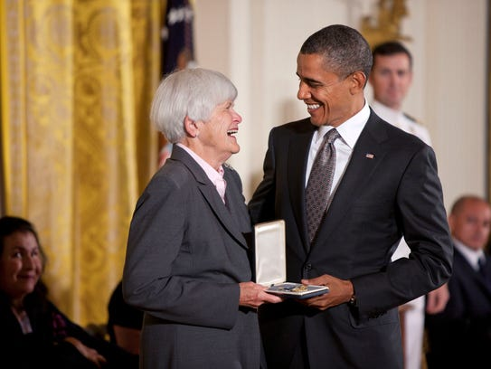 President Barak Obama honors Liz Putnam, one of 13