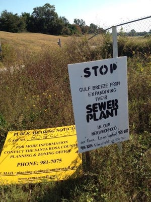 Santa Rosa Shores residents posted signs protesting Gulf Breeze's plan to purchase the Tiger Point golf course.
