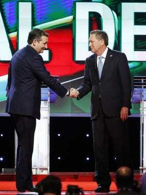 Republican presidential candidate, Sen. Ted Cruz, R-Texas, left,  shakes hands with Republican presidential candidate, Ohio Gov. John Kasich, at the start of the Republican presidential debate sponsored by CNN, Salem Media Group and the Washington Times at the University of Miami Thursday.
