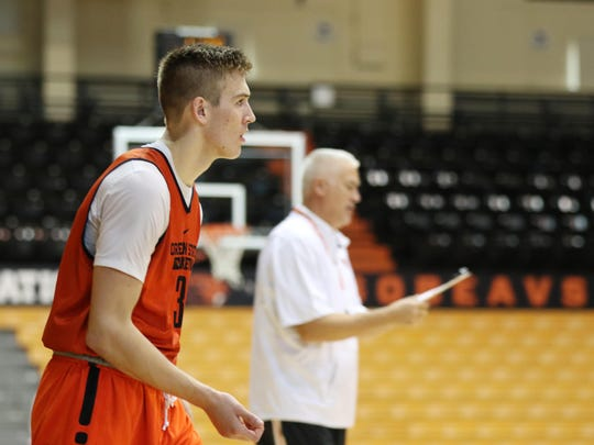 Oregon State's Tres Tinkle waits for instruction by his father and coach Wayne Tinkle, center, during practice Tuesday at Gill Coliseum in Corvallis.