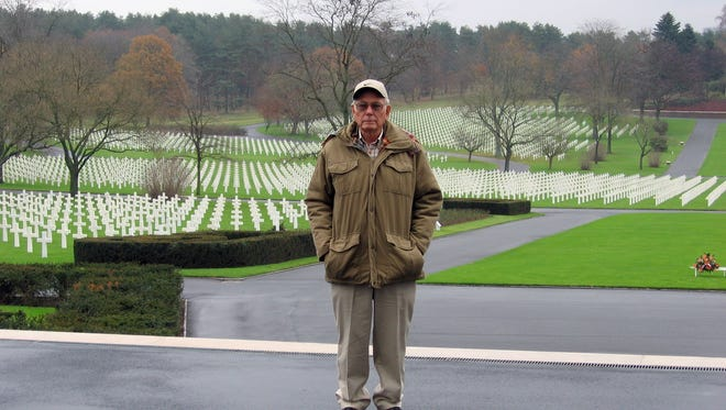 David Harvey stands amid graves of fallen U.S. soldiers in a French town he helped liberate during World War II. Harvey of Stuarts Draft passed away April 9, 2015 the day after receiving the French Legion of Honor for his service.