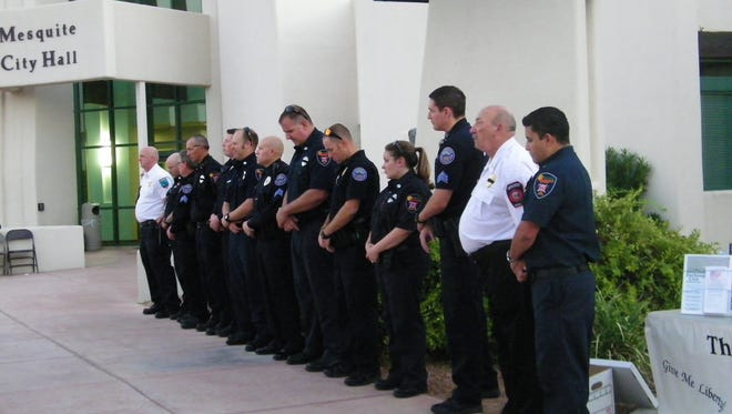 Mesquite Police and Fire pause for a moment of silence.