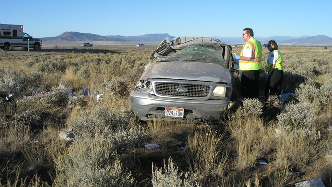 A woman was injured Sunday after nearly striking a Utah Highway Patrol officer and rolling her vehicle off Interstate 15 near Parowan.